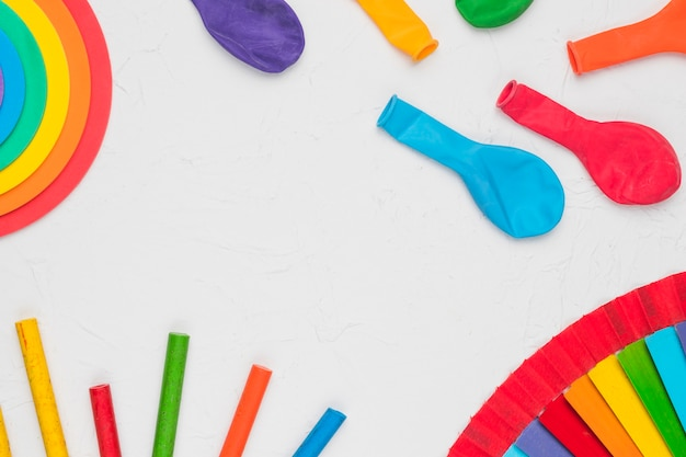 Composition of balloons pencils and decorative lgbt elements Free Photo