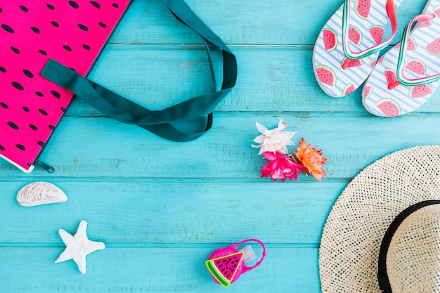 Composition of beach accessories on blue background Free Photo