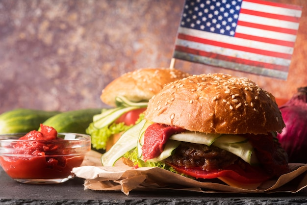 Composition of delicious hamburgers Free Photo