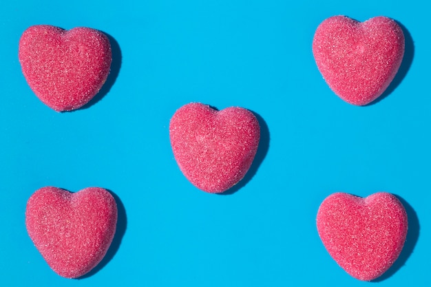 Composition of delicious sweet heart candies Free Photo