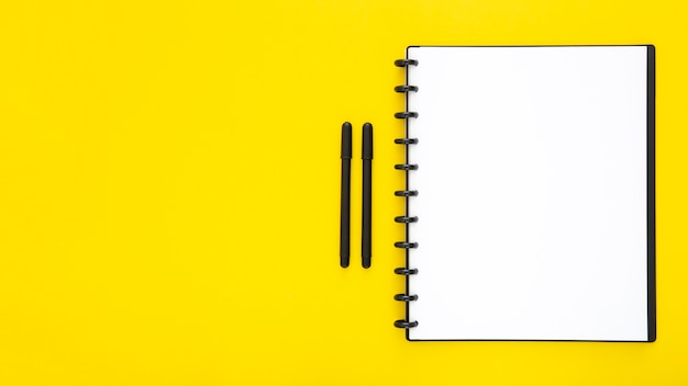 Composition of desk elements on yellow background Premium Photo