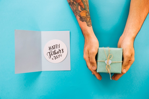 Composition for fathers day with hands holding present Free Photo