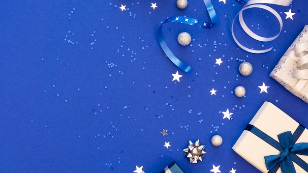 Composition of festive wrapped gifts with copy space Free Photo