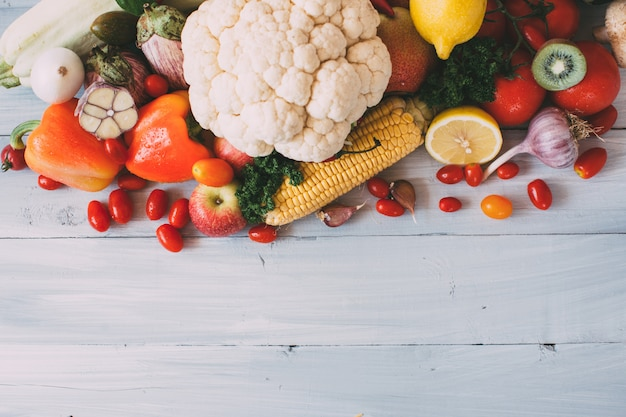 Composition of fresh vegetables on a wood Premium Photo