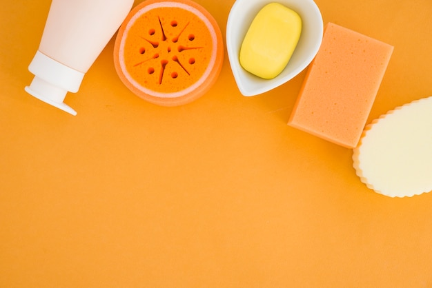Composition of health care products on orange background Free Photo