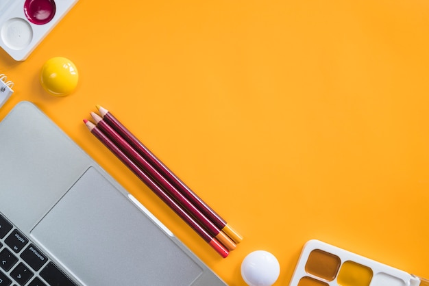 Composition of laptop and stationery tools for painting Free Photo