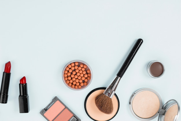 Composition of makeup beauty accessories on light background Free Photo
