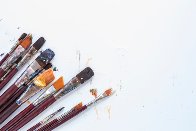 Composition of messy stationery tools for drawing Free Photo