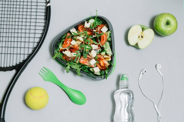 Composition of tennis equipment and useful food 23 2147829391