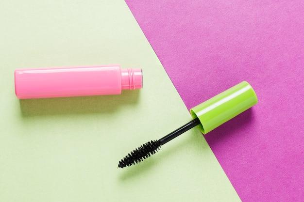 Composition of opened mascara with black brush Free Photo