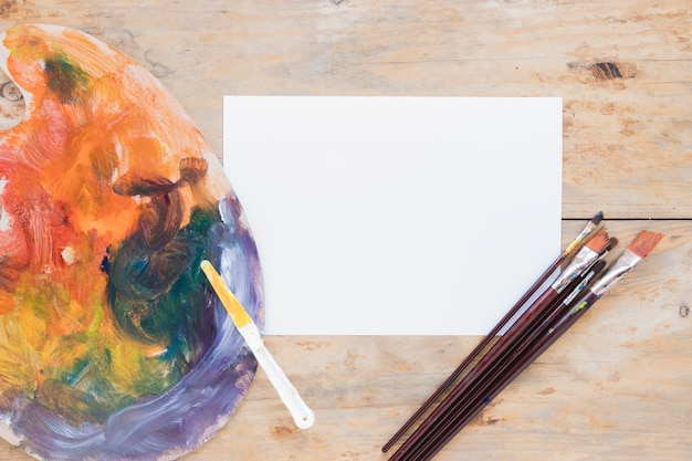 Composition of painting tools on wooden desk Free Photo