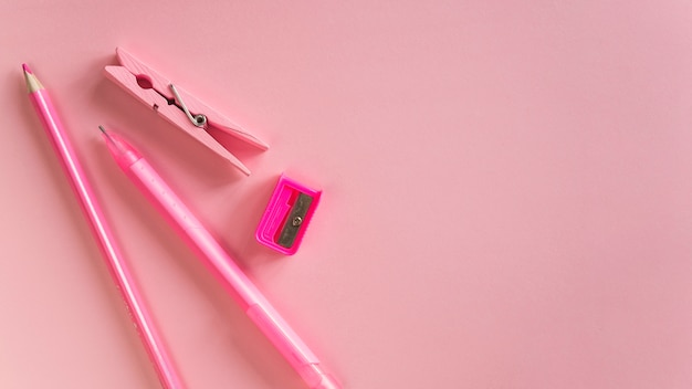 Composition of pink stationery school tools Free Photo