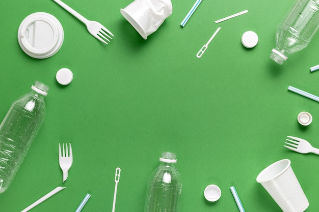Composition of plastic waste pollution. sorting and recycling. disposable packaging. ecological concept. flat lay, top view, copy space. Premium Photo