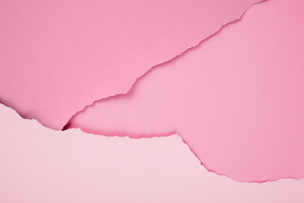 Composition of ripped pink papers Free Photo