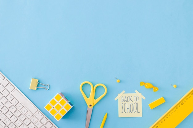 Composition of school accessories on blue Premium Photo