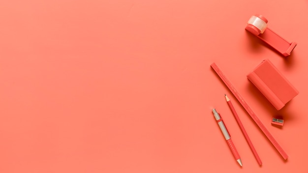 Composition of school supplies in pink color Free Photo