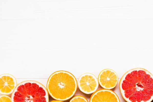 Composition of sliced tropical citrus fruits Free Photo