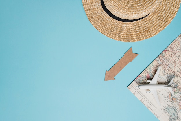 Composition of small airplane map hat and arrow Free Photo