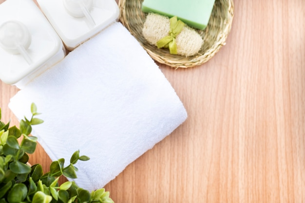 Composition of spa treatment on wooden table. Premium Photo