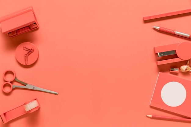 Composition of stationery supplies in pink color Free Photo