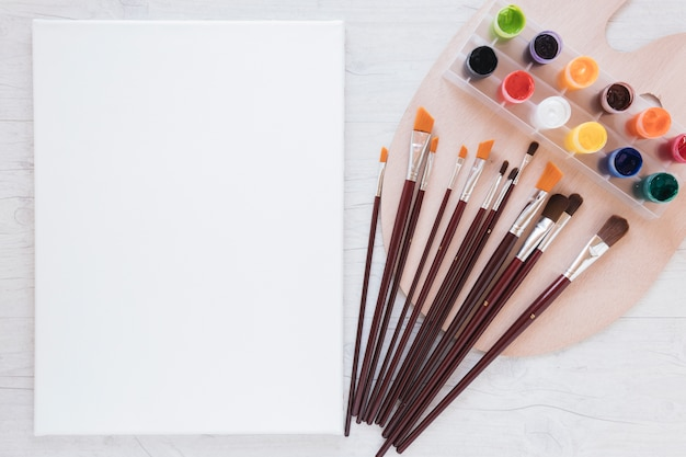 Composition of stationery tools for drawing and paper Free Photo