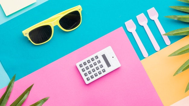 Composition of summer and office things on multicolored surface Free Photo