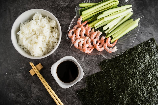 Composition of sushi ingredients and kitchenware Free Photo