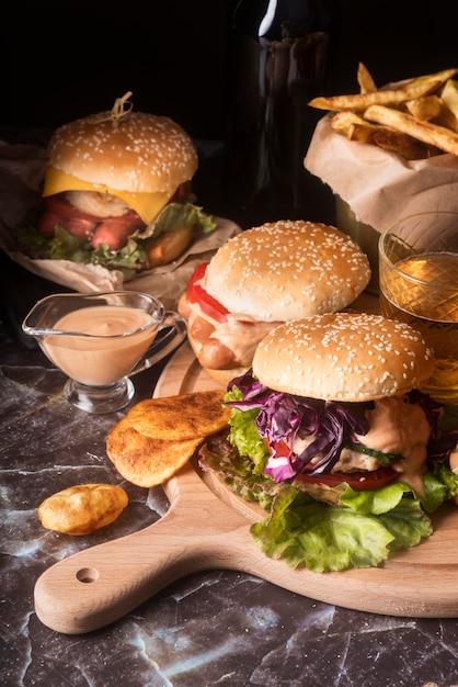 Composition of tasty hamburgers Free Photo