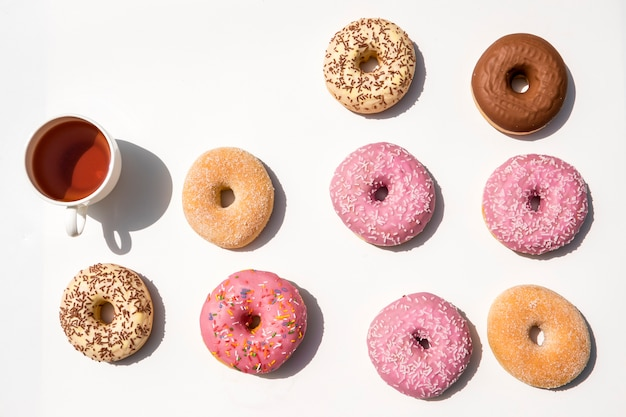 Composition of tea with donuts Free Photo