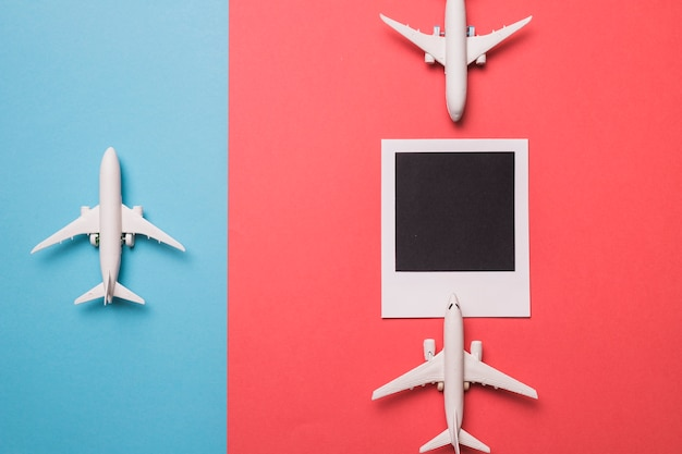 Composition of toy airplanes and instant frame Free Photo