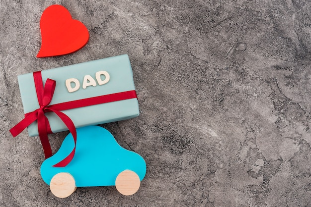 Composition of toy car and gift box for father`s day Free Photo