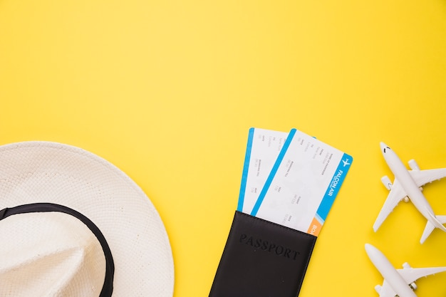 Composition of toy planes passport tickets and hat Free Photo