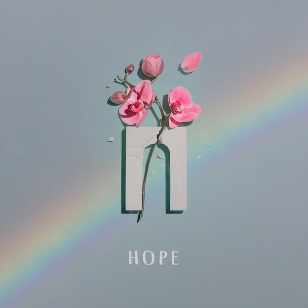 ミントに壊れたアーチとピンクの蘭の花の構成。 Premium写真