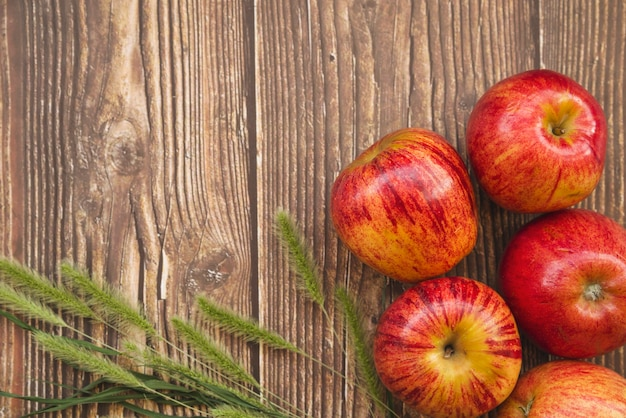 Composition with apples and green spikes Free Photo