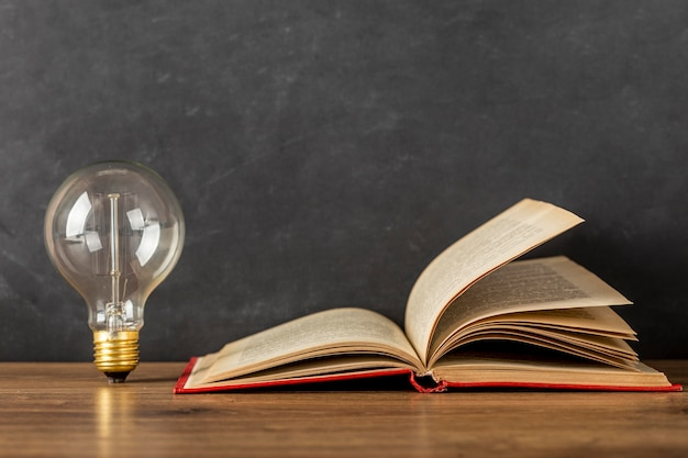 Composition with book and light bulb Free Photo