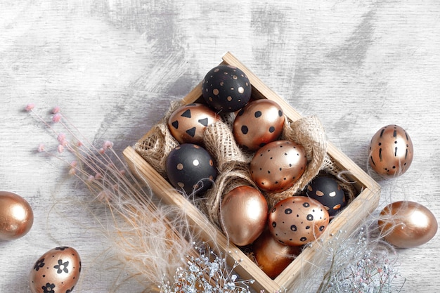 Composition with easter eggs painted in gold and black. Free Photo