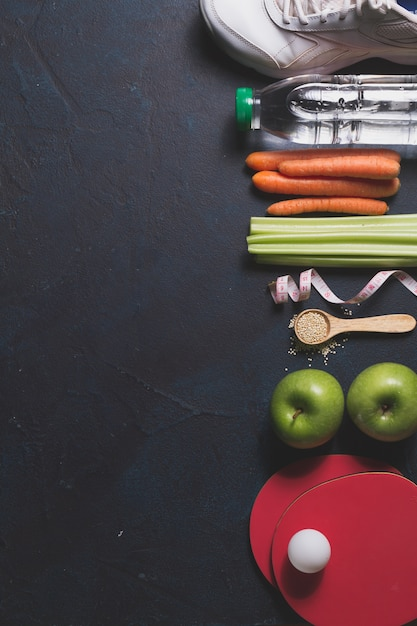 Composition with healthy food and sport items Free Photo