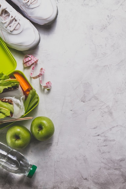 Composition with healthy food and tape measure Free Photo