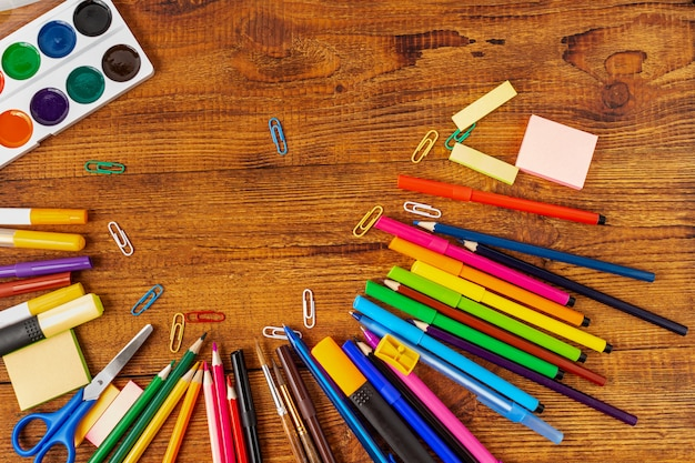 Composition with notebook blank page colorful pencil, marker and pen mock-up back to school concept Premium Photo