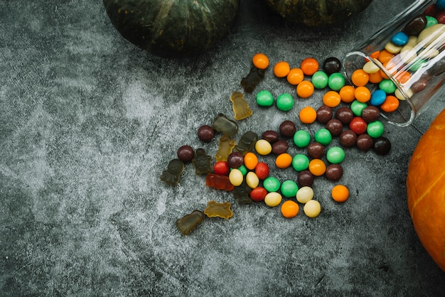 Composition with pumpkin and candies Free Photo