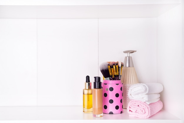 Composition with spa cosmetic and brush for face, isolated on white Premium Photo