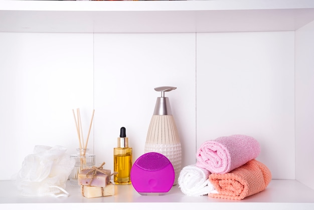 Composition with spa cosmetic, candles and brush for face, isolated on white Premium Photo