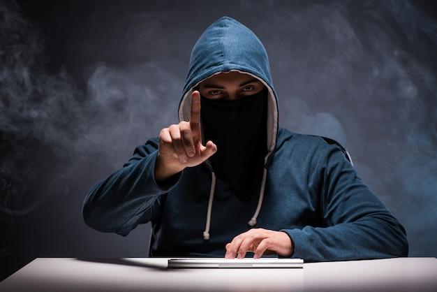 Computer hacker working in dark room Premium Photo