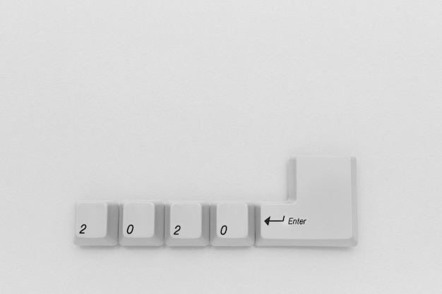 Computer keyboard keys with 2020 enter written using the white buttons on white background Premium Photo