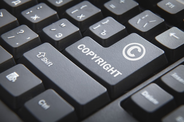 Computer keyboard with a word copyright. Premium Photo