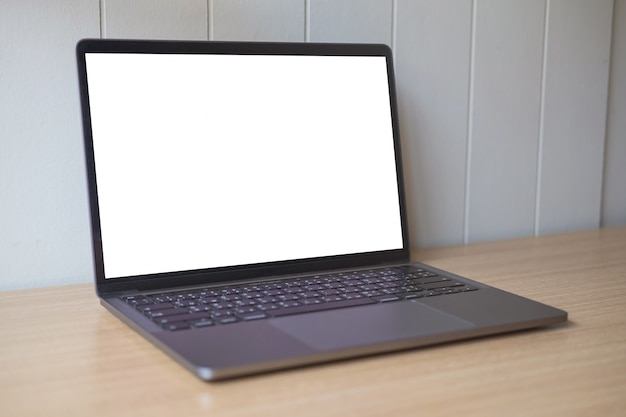 Computer mockup white background on table. laptop with blank screen. Premium Photo