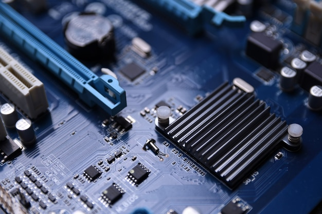 Computer motherboard and electronical components cpu gpu memory and different sockets for video card close up Premium Photo