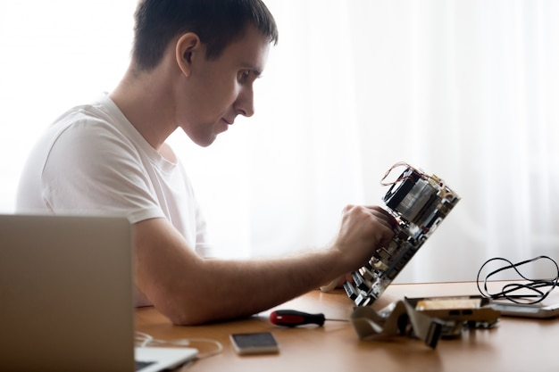 Computer technician repairing motherboard Free Photo