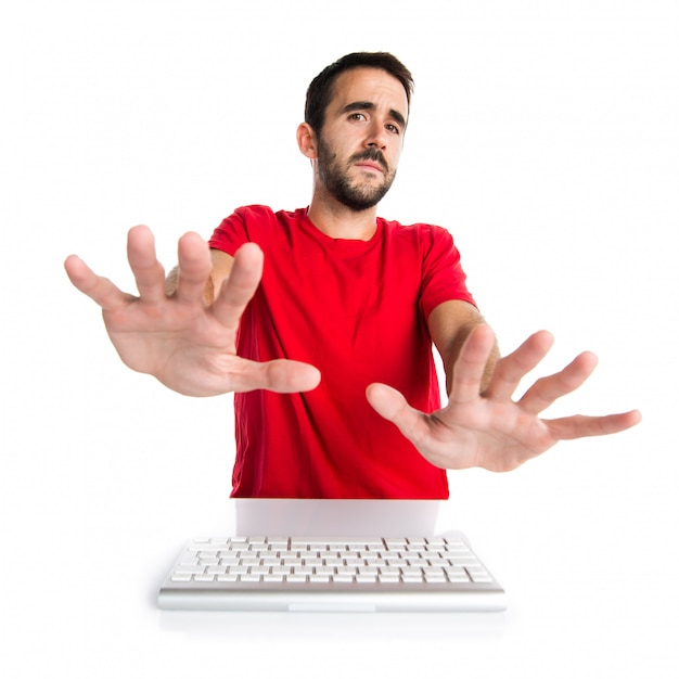 Computer technician working with his keyboard making stop sign Premium Photo