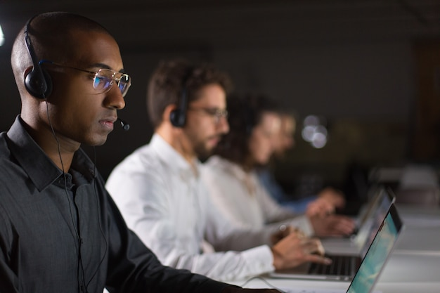 Concentrated african american call center operator working Free Photo